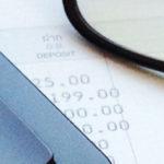glasses next to calculator