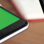 closeup of money transfer through smartphones